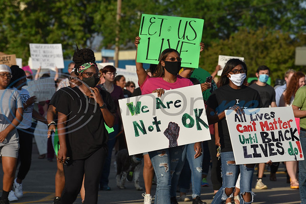 Protesters march down Commerce Street in Jacksonville on Wednesday, June 3 to protest the death of George Floyd.