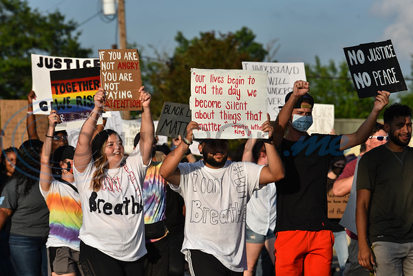 Protesters gathered with signs at a Unity Rally in downtown Jacksonville on Wednesday, June 3 to protest the death of George Floyd.