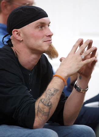 Globe/T. Rob Brown<br /> Jered Jackson of Newton County listens during a recovery meeting Sunday, Nov. 27, 2006, at Shoal Creek Revival Church east of Granby.<br /> Section: Special Section - Meth Story: Max McCoy