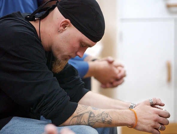 Globe/T. Rob Brown<br /> Jered Jackson of Newton County prays during a recovery meeting Sunday, Nov. 27, 2006, at Shoal Creek Revival Church east of Granby.<br /> Section: Special Section - Meth Story: Max McCoy