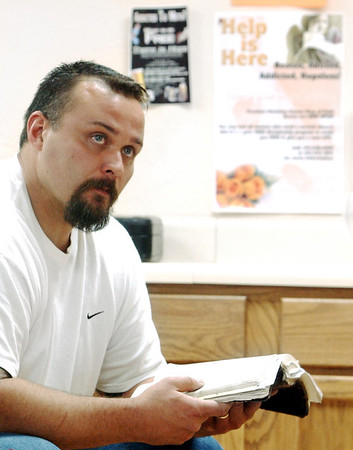 Globe/T. Rob Brown<br /> Steve Box of Pierce City pauses from reading the Holy Bible to look up at a speaker during a recovery meeting Sunday, Nov. 27, 2006, at Shoal Creek Revival Church east of Granby.<br /> Section: Special Section - Meth Story: Max McCoy