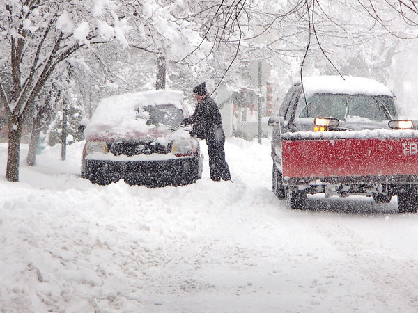 Times Sentinel photo<br /> Maple Street resident Don Steffy clears off his car as the snow was still coming down Sunday, Jan. 5.