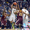 J.S.CARRAS/THE RECORD  Siena's Evan Hines (5) drives to the basket against Iona during first half of men's college basketball action Sunday, January 12, 2014 at the Times Union Center in Albany, N.Y..