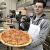 Mike McMahon - The Record, Pomodoro Pizza & Catering owner Jared Horton with first pizza on opening day at 279 Burden Ave Troy restaurant.  January 29, 2014.