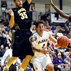 J.S.Carras/The Record  UMBC's Brett Roseboro (35) defends at the basket as UAlbany's Levan Shengelia (4) passes off during first half of men's college basketball action Wednesday, January 08, 2014 at SEFCU Arena in Albany, N.Y..