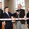 J.S.CARRAS/THE RECORD Developer Auri Kaufman helps Cohoes Mayor George Primeau, Sr., with scissors to cut ribbon as assemblyman John McDonald, III., and Cohoes Councilwoman April Kennedy look on Thursday, January 16, 2014 for Lofts of Harmony Mills West in Cohoes, N.Y..