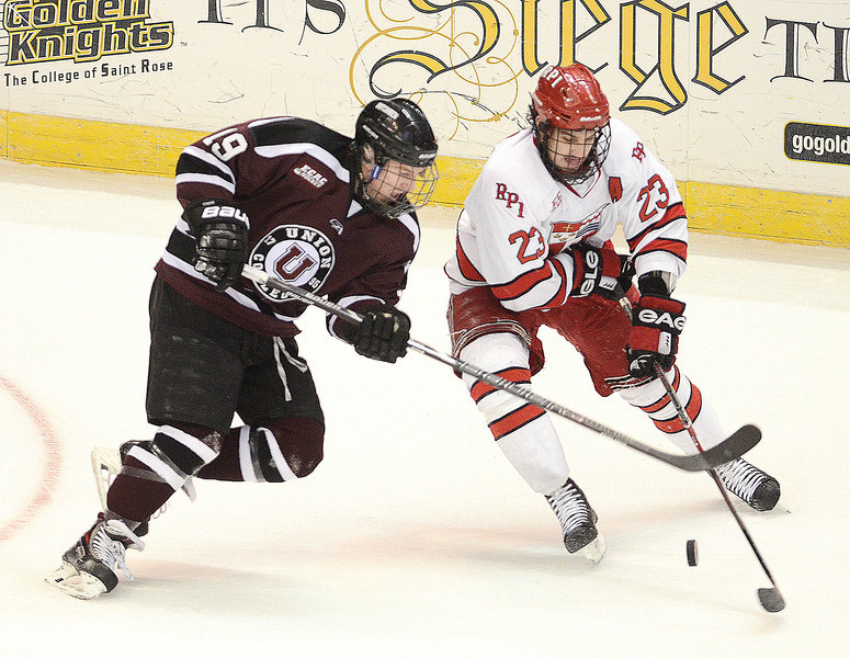 J.S.Carras/The Record  Union's Matt Wilkins (19) checks Rensselaer Polytechnic Institute's Brock Higgs (23) during first period of Mayors Cup college hockey action Saturday, January 25, 2014 at the Times Union Center in Albany, N.Y..