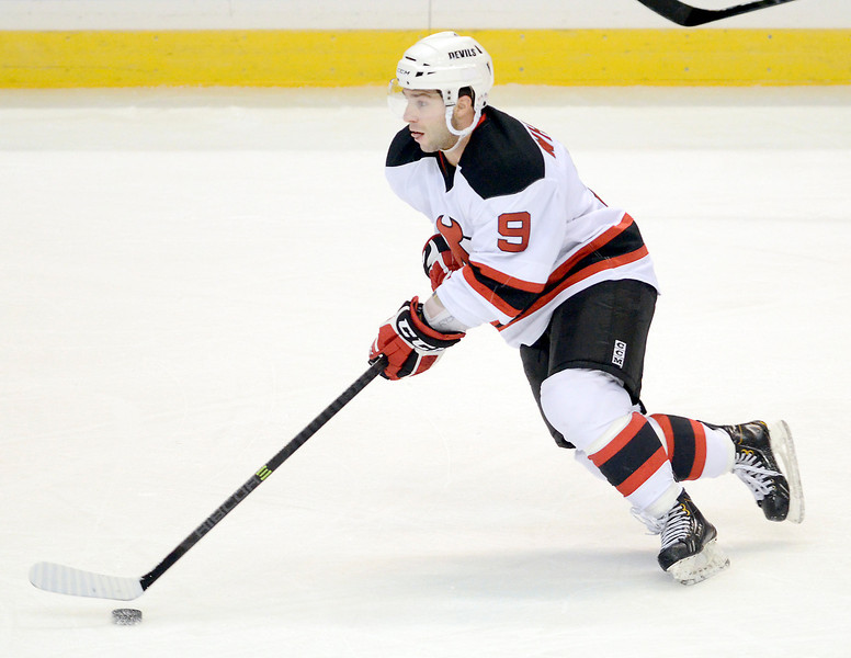 J.S.CARRAS/THE RECORD  Albany Devils Joe Whitney (9) carries puck against Bridgeport Tigers during first period of AHL actionMonday, November 11, 2013 at Times Union Center in Albany, N.Y..