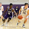 J.S.Carras/The Record  CCHS's Raiquin Harris pressures CBA's Jacob Foglia (14) during second quarter of high school boys basketball action Tuesday, January 07, 2014 at Christian Brothers Academy in Colonie, N.Y..