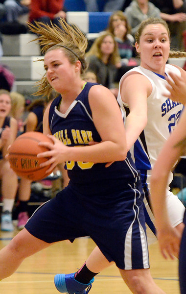 J.S.Carras/The Record  Averill Park's Caraline Wood pulls rebound from Shaker's Sage VanAmerongen during first quarter of high school girls basketball action Tuesday, January 21, 2014 at Shaker High School in Latham, N.Y..