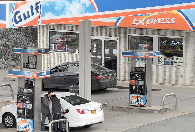 Mike McMahon - The Record, The Golf Express gas station on Hoosick Street in Troy was robbed at gunpoint last night,  January 18, 2014.