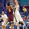 J.S.CARRAS/THE RECORD  Iona's A.J. English (5) puts up shot as Siena's Rob Poole (33) defends  during first half of men's college basketball action Sunday, January 12, 2014 at the Times Union Center in Albany, N.Y..