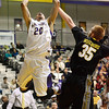 J.S.Carras/The Record  UMBC's Brett roseboro (35) defends against UAlbany's Gary Johnson (20) as he drives to the basket during first half of men's college basketball action Wednesday, January 08, 2014 at SEFCU Arena in Albany, N.Y..