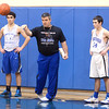 J.S.CARRAS/THE RECORD Hoosick Falls basketball coach Mike Lilac puts ball into play during high school basketball practice Wednesday, January 08, 2014 at Hoosick Falls High School in Hoosick Falls, N.Y..