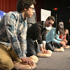 Mike McMahon - The Record, Shaker High School senior Youssef Elasser at left with fellow students,   learns to do Hands-Only CPR at a American Heart Association announcement for month-long CPR trainings throughout the county.  January 27, 2014.