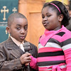 Mike McMahon - The Record, Majachi Rodgers-Gamble and Anyra Everett both age 6 give the welcome at The Troy Area United Ministries Interfaith Martin Luther King service at the Bethel Paptist Church in Troy,  January 19, 2014.