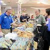 J.S.CARRAS/THE RECORD John Eberts, sales dirctor at Sky Blue Bakery in Agawam, Ma., pitches their products to Scott Stowell and Wendy Lemperle of Schenectady School District for area school lunch programs Tuesday, January 14, 2014 at the Polish Community Center in Albany, N.Y..