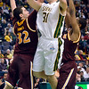 J.S.CARRAS/THE RECORD  Iona's Ryden Hines (32) and Sean Arnold (r) defend as Siena's Brett Bisping (31) drives to the basket during first half of men's college basketball action Sunday, January 12, 2014 at the Times Union Center in Albany, N.Y..