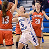J.S.CARRAS/THE RECORD Hoosic Valley's Alyssa Paul (15) goes to the basket between Cambridge defenders Olivia Mooney (13) and Sarah Cuddihy (20) during second quarter of high school girls basketball action Wednesday, January 22, 2014 at Hoosic Valley in Schaghticoke, N.Y..