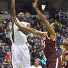 J.S.CARRAS/THE RECORD  Iona's David Laury defends as Siena's Imoh Silas (34) goes to the basket during first half of men's college basketball action Sunday, January 12, 2014 at the Times Union Center in Albany, N.Y..