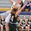 J.S.Carras/The Record  Averill Park's Caraline Wood (33) drives to the basket on Shenendehowa's Ashley Acker (24) during first quarter of high school girls basketball action Friday, January 17, 2014 at Averill Park High School in Averill Park, N.Y..