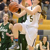 J.S.Carras/The Record  Averill Park's Kelly Donnelly (5) drives to the basket past Shenendehowa's Sydney Brown during first quarter of high school girls basketball action Friday, January 17, 2014 at Averill Park High School in Averill Park, N.Y..