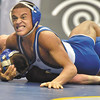 Jeff Couch/The Record  Hoosick Falls Luis Weierbach top from section II wins over Danny Fox from Dolgevill- section III