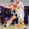 J.S.Carras/The Record  CBA's Greig Stire (54) passes off in front of CCHS defender Anthony Mack (25) during second quarter of high school boys basketball action Tuesday, January 07, 2014 at Christian Brothers Academy in Colonie, N.Y..