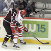 J.S.Carras/The Record  Rensselaer Polytechnic Institute's Zach Schroeder protects the puck from Union's Cole Ikkala (23) during first period of Mayors Cup college hockey action Saturday, January 25, 2014 at the Times Union Center in Albany, N.Y..