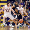 J.S.CARRAS/THE RECORD Binghamton's Marlon Beck, II, attemps to escape double team defense by UAlbany's John Puk (44) and David Wiegmann during first half of men's college basketball action Monday, January 20, 2014 at SEFCU Arena in Albany, N.Y..
