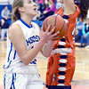 J.S.CARRAS/THE RECORD Hoosic Valley's L'Rae Brundige drives to the basket past Cambridge defender Olivia Mooney during second quarter of high school girls basketball action Wednesday, January 22, 2014 at Hoosic Valley in Schaghticoke, N.Y..
