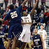 J.S.Carras/The Record  Troy's Dyaire Holt (11) uses the glass against Newburgh Free Academy's Ja'kwan Jones (25) during second quarter action in the Albany Academy High School Challenge basketball action Sunday, January 26, 2014 at Watervliet High School in Watervliet, N.Y..