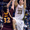 J.S.CARRAS/THE RECORD  Iona's Ryden Hines (32) defends as Siena's Rob Poole (33) drives to the basket during first half of men's college basketball action Sunday, January 12, 2014 at the Times Union Center in Albany, N.Y..