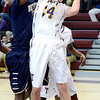 J.S.Carras/The Record  Troy's Connor Nicoll works inside against Newburgh Free Academy's Ja'kwan Jones during second quarter action in the Albany Academy High School Challenge basketball action Sunday, January 26, 2014 at Watervliet High School in Watervliet, N.Y..