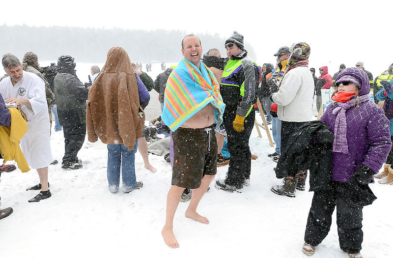 J.S.CARRAS/THE RECORD Matt Jaworski of Troy dries off as one of only about a dozen people braved the icy waters of Long Pond during the 7th annual Polar Plunge hosted by Cystic Fibrosis Foundation during 29th annual Winter Festival and Fishing Contest Saturday, January 25, 2014 at Grafton Lakes State Park in Grafton, N.Y..