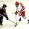 J.S.Carras/The Record  Union's Shayne Gostisbehere (14) blocks shot by Rensselaer Polytechnic Institute's Brock Higgs (23) during first period of Mayors Cup college hockey action Saturday, January 25, 2014 at the Times Union Center in Albany, N.Y..