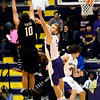 J.S.CARRAS/THE RECORD Binghamton's Yosef Yacob (10) puts up fade away shot against UAlbany's Anders Haas (5) during first half of men's college basketball action Monday, January 20, 2014 at SEFCU Arena in Albany, N.Y..