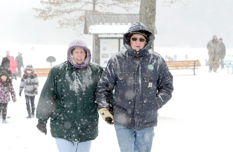 J.S.CARRAS/THE RECORD Lisa and Barney Dooley of Grafton walk through the snow during 29th annual Winter Festival and Fishing Contest Saturday, January 25, 2014 at Grafton Lakes State Park in Grafton, N.Y..