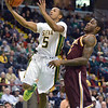J.S.CARRAS/THE RECORD  Siena's Evan Hines (5) drives to the basket against Iona's A.J. English during first half of men's college basketball action Sunday, January 12, 2014 at the Times Union Center in Albany, N.Y..