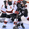 J.S.CARRAS/THE RECORD  Manchester Monarchs A.J. Gale (17) is pushed out of the crease by Albany Devils Adam Larsson (5) during first period of AHL hockey action Saturday, January 11, 2014 at the Albany Times Union Center in Albany, N.Y..