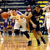 J.S.Carras/The Record   UAlbany's Gary Johnson steals the ball from Binghamton's Yosef Yacob (10) during first half of men's college basketball action Monday, January 20, 2014 at SEFCU Arena in Albany, N.Y..