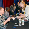 J.S.Carras/The Record  New York Yankee Shawn Kelley signs baseballs for Pam Zovistoski of Niskayuna in front of New York Giant Andre Brown (wearing hat) during the 54th annual Center for Disability Services Telethon Sunday, January 26, 2014 at The Holiday Inn Albany on Wolf Road in Colonie, N.Y..