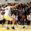 J.S.Carras/The Record  CCHS' Jiriem Tedder (13) drives against CBA's Greig Stire (54) during second quarter of high school boys basketball action Tuesday, January 07, 2014 at Christian Brothers Academy in Colonie, N.Y..