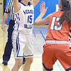 J.S.CARRAS/THE RECORD Hoosic Valley's Alyssa Paul (15) looks to pass over Cambridge defenders Olivia Mooney (13) during second quarter of high school girls basketball action Wednesday, January 22, 2014 at Hoosic Valley in Schaghticoke, N.Y..