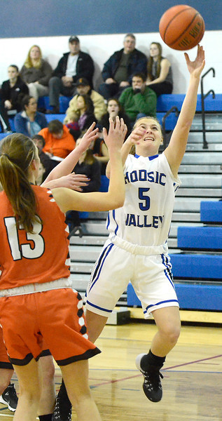 J.S.CARRAS/THE RECORD Hoosic Valley's Sam Carlo (5) drive to the basket against Cambridge during first quarter of high school girls basketball action Wednesday, January 22, 2014 at Hoosic Valley in Schaghticoke, N.Y..