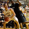 J.S.Carras/The Record  Binghamton's Alex Ogundadegbe (15) fouls UAlbany's sam Rowley (14) under the basket during first half of men's college basketball action Monday, January 20, 2014 at SEFCU Arena in Albany, N.Y..