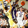 J.S.Carras/The Record  CCHS' Raiquis Harris (2) drives to the basket between CBA's Matt Hamel (22) and Ian Schultz (31) during second quarter of high school boys basketball action Tuesday, January 07, 2014 at Christian Brothers Academy in Colonie, N.Y..