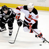 J.S.CARRAS/THE RECORD  Manchester Monarchs Jordan Weal (19) defends against  Albany Devils Harri Personen (15) during first period of AHL hockey action Saturday, January 11, 2014 at the Albany Times Union Center in Albany, N.Y..
