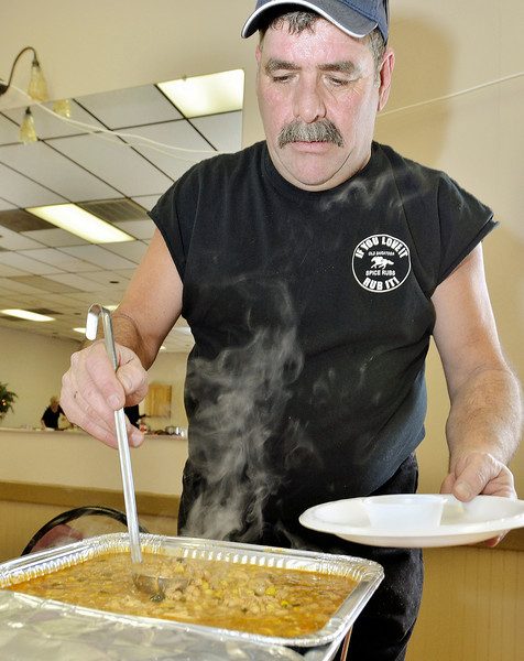 Mike McMahon - The Record, Paul Greenberg ladles some of his White Chicken Chili at the Chili Challenge at The Brunswick Elks Lodge,  January 18, 2014.