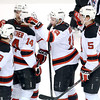 J.S.CARRAS/THE RECORD  Albany Devils Mike Sislo (second from right) is congratulated by teammates after scoring against Adirondack Phantoms during first period of AHL hockey action Saturday, January 25, 2014 at the Times Union Center in Albany, N.Y..